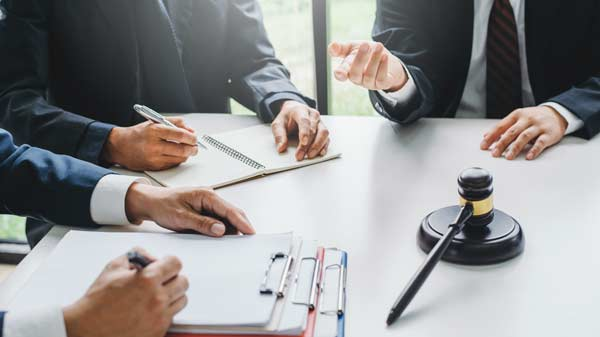 Divorce lawyers negotiating on behalf of their clients